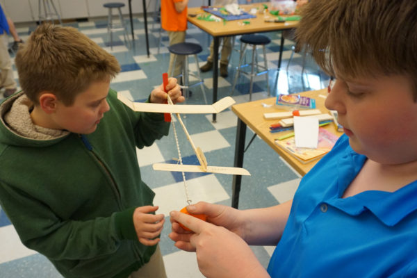 Two boys work together on a project in class at Ashbrook Independent School