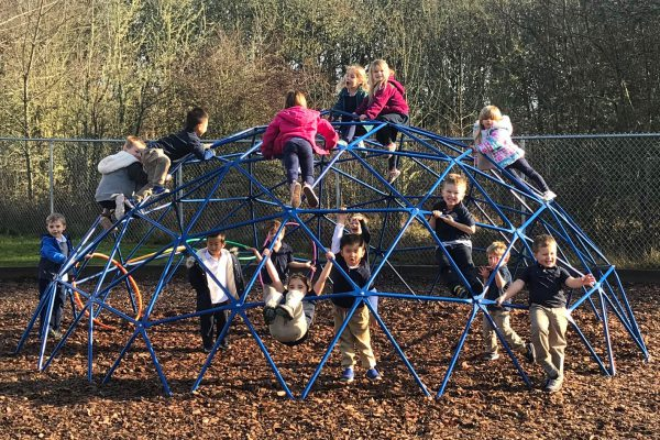 Students play on the playground at Ashbrook Independent School